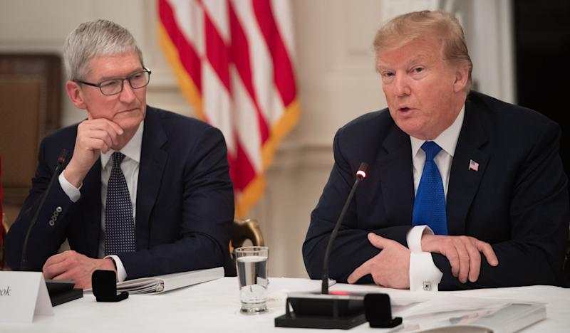US President Donald Trump speaks alongside Apple CEO Tim Cook (L) during the first meeting of the American Workforce Policy Advisory Board in the State Dining Room of the White House in Washington, DC, March 6, 2019. (Photo by SAUL LOEB / AFP) (Photo credit should read SAUL LOEB/AFP/Getty Images)