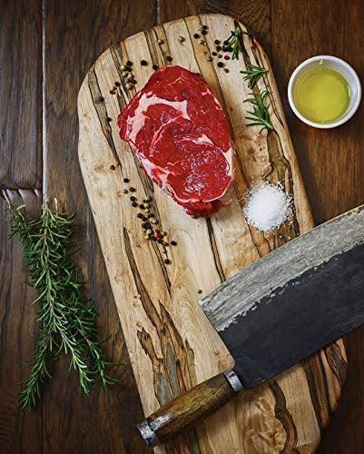 <p>Whether they love to cook up a storm in the kitchen or assemble the coolest charcuterie boards, the <span>Large Long Ambrosia Maple Wood Cutting Board with Handle</span> ($49) is something they'll use all the time. Plus, it's great as a decor piece in their kitchen.</p>