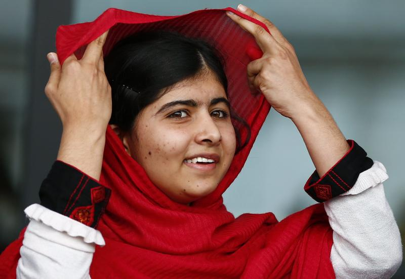 Malala Yousafzai reacts after speaking at the opening of Birmingham Library