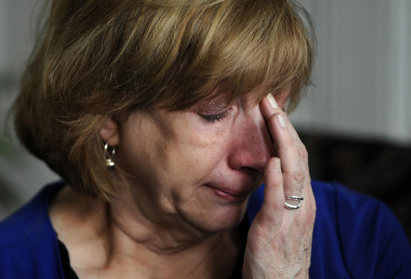 Teresa Rousseau wipes tears from her eyes while talking about her daughter Lauren Rousseau during an interview with the Associated Press at her home in Danbury, Conn., Tuesday, Feb. 5, 2013. Lauren Rousseau, 30, a teacher, was one of 26 people killed in the Dec. 14, 2012 massacre at Sandy Hook Elementary School in Newtown, Conn.  Lauren Rousseau will be one of six educators from the school honored posthumously with the 2012 Presidential Citizens Medal, presented at a White House ceremony on Feb. 15. (AP Photo/Jessica Hill)