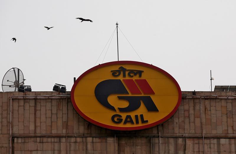 FILE PHOTO: Birds fly past the logo of India's state-owned natural gas utility GAIL (India) Ltd in New Delhi