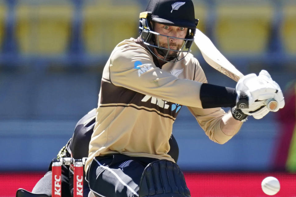 FILE - In this March 7 , 2021, file photo, New Zealand's Devon Conway bats against Australia during their 5th T20 cricket international match at Wellington Regional Stadium in Wellington, New Zealand. Africa-born batsman Conway has been named among three uncapped players in the New Zealand cricket team which will play two tests in England in June. (John Cowpland/Photosport via AP, File)