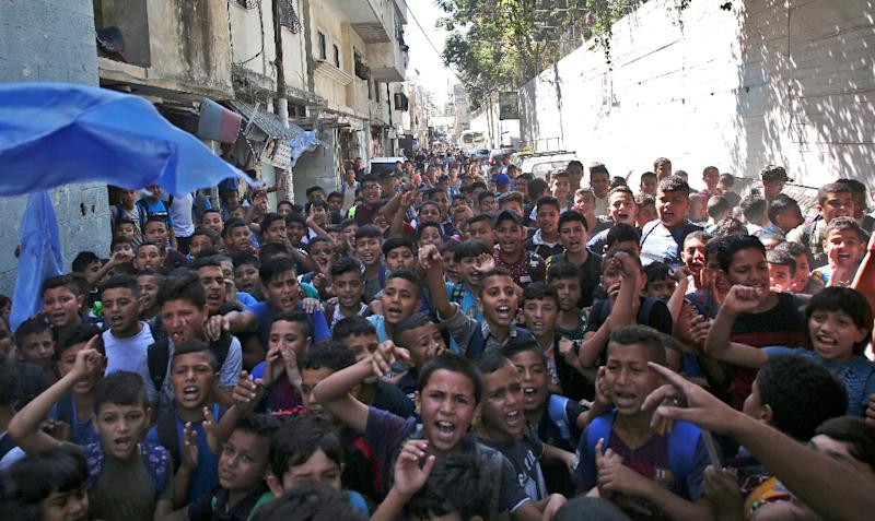 Palestinian pupils protest in front of a school administered by the United Nations Relief and Works Agency (UNRWA)and financed by US aid, in the Balata refugee camp near Nablus in the occupied West Bank