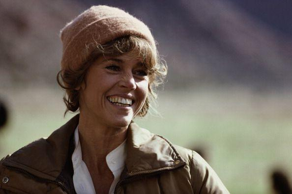 <p>Here, Fonda smiles on the set of <em>The Electric Horseman</em>, which she starred as Hallie alongside Robert Redford. <br></p>