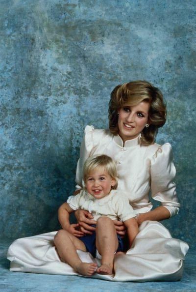 <p>Here, a 2-year-old Prince William happily poses for a photograph in May 1984 with his fashionable mom in front of a very '80s backdrop.</p>