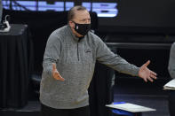 New York Knicks coach Tom Thibodeau reacts during the first half of the team's NBA basketball game against the Golden State Warriors in San Francisco, Thursday, Jan. 21, 2021. (AP Photo/Jeff Chiu)