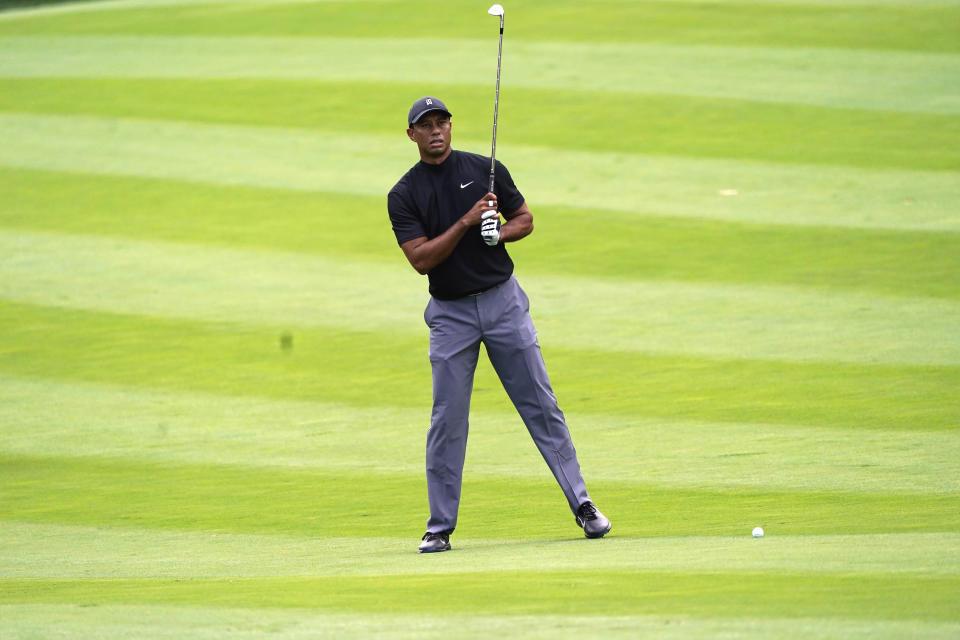 Tiger Woods measures his shot on the 11th fairway during the first round of the Zozo Championship golf tournament Thursday, Oct. 22, 2020, in Thousand Oaks, Calif. (AP Photo/Marcio Jose Sanchez)