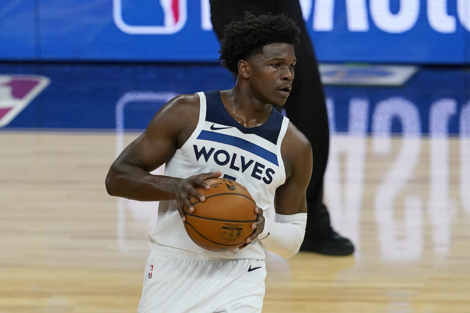 Minnesota Timberwolves guard Anthony Edwards looks to pass the ball against the Golden State Warriors during the first half of an NBA basketball game in San Francisco, Wednesday, Jan. 27, 2021. (AP Photo/Jeff Chiu)