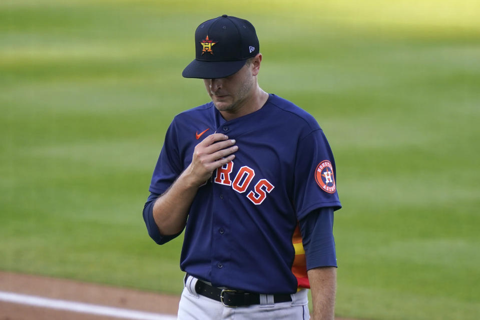 Houston Astros starting pitcher Jake Odorizzi walks to the dugout after being relieved during the first inning of a spring training baseball game against the Washington Nationals, Wednesday, March 24, 2021, in West Palm Beach, Fl. (AP Photo/Lynne Sladky)