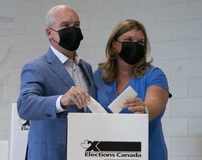 <p>Conservative leader Erin O'Toole and Rebecca O'Toole cast their ballot in the federal election Monday, Sept. 20, 2021 in Bowmanville, Ont. THE CANADIAN PRESS/Adrian Wyld</p>