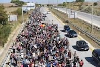 Syrian migrants and refugees march towards Greece along a highway on September 18, 2015, on their way to the border between Turkey and Greece (AFP Photo/Bulent Kilic)