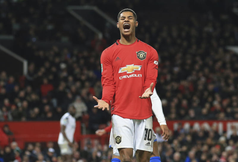 FILE - In this Wednesday, Dec. 18, 2019 file photo Manchester United's Marcus Rashford, reacts during the English League Cup quarter final soccer match between Manchester United and Colchester United at Old Trafford in Manchester, England. British Prime Minister Boris Johnson made an abrupt about-face Tuesday June 16, 2020 and agreed to keep funding meals for needy pupils over the summer holidays, after a campaign headed by young soccer star Marcus Rashford. The Manchester United and England player has been pressing the government not to stop a meal voucher program at the end of the school term in July. (AP Photo/Jon Super, File)