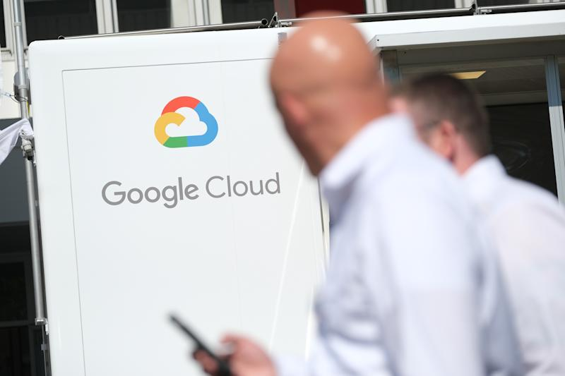 FRANKFURT AM MAIN, GERMANY - SEPTEMBER 11: People walk past a Google Cloud exhibit during the press days at the 2019 IAA Frankfurt Auto Show on September 11, 2019 in Frankfurt am Main, Germany. The IAA will be open to the public from September 12 through 22. (Photo by Sean Gallup/Getty Images)