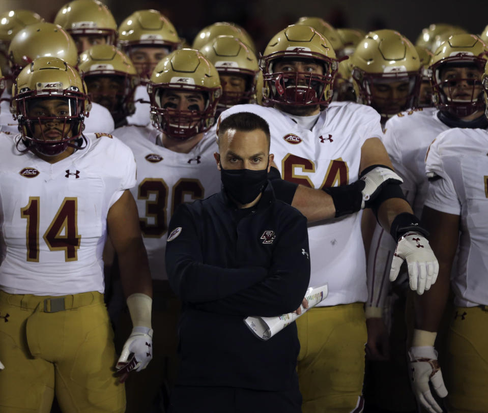 Boston College head coach Jeff Hafley and his team wait to take the field at the start of the first half of an NCAA college football game against Virginia Tech in Blacksburg Va. Saturday, Oct. 17, 2020. (Matt Gentry/The Roanoke Times via AP, Pool)