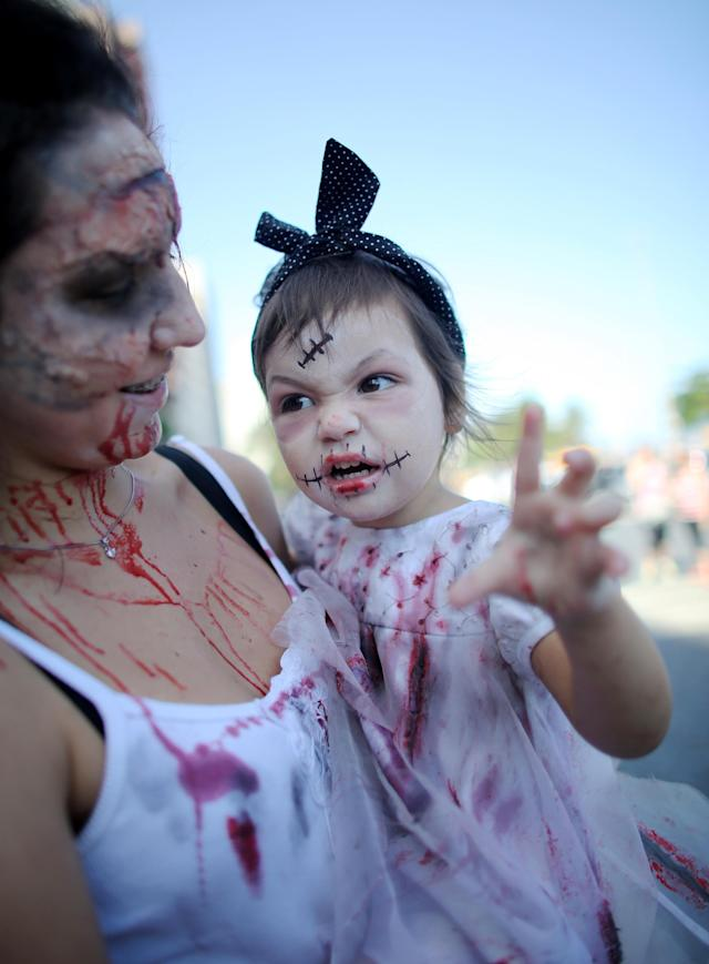 RIO DE JANEIRO, BRAZIL - NOVEMBER 02: A child dressed as a zombie poses before a 'Zombie Walk' along Copacabana Beach during Day of the Dead festivities on November 2, 2013 in Rio de Janeiro, Brazil. Brazilians often mark the traditional Latin American holiday by visiting loved ones' graves while the Zombie Walk offers a modern twist. (Photo by Mario Tama/Getty Images)