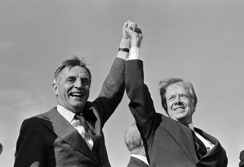 President Jimmy Carter, right, and Vice President Walter Mondale share a victory salute at the Akron-Canton Municipal Airport in Akron, Ohio, Nov. 3, 1980. They addressed a rally of about 4,000 people before taking off for another campaign stop. (AP Photo/Jim Wells)