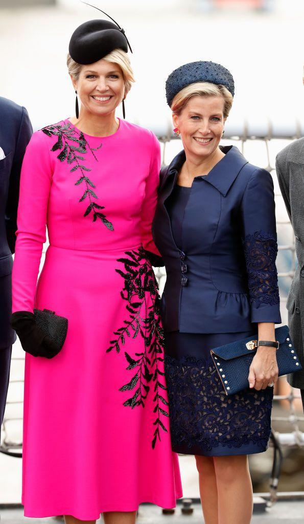 """<p>The Countess of Wessex wore a navy dress and matching jacket with ornate detailing paired with a navy hat as she attends a Royal Marines and Royal Netherlands Marine demonstration on the River Thames with Queen Maxima of the Netherlands. The Queen of the Netherlands is in London for the <a href=""""https://www.townandcountrymag.com/society/tradition/g24107967/king-willem-alexander-queen-maxima-dutch-state-visit-uk-queen-elizabeth-photos/"""" rel=""""nofollow noopener"""" target=""""_blank"""" data-ylk=""""slk:Dutch State visit"""" class=""""link rapid-noclick-resp"""">Dutch State visit</a>. </p>"""