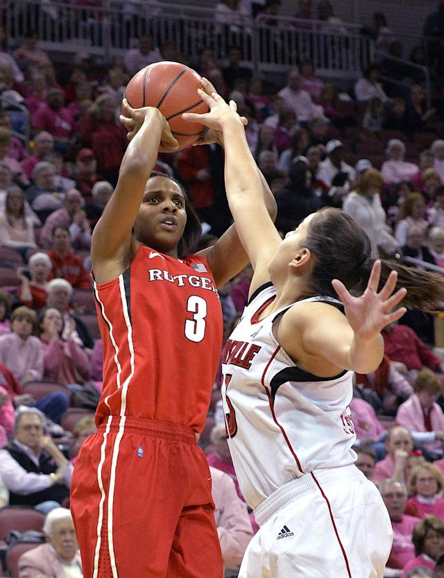 Rutgers' Tyler Scaife, left, puts up a shot over the defense of Louisville's Shoni Schimmel during the first half of an NCAA college basketball game Sunday, Feb. 23, 2014, in Louisville, Ky. (AP Photo/Timothy D. Easley)