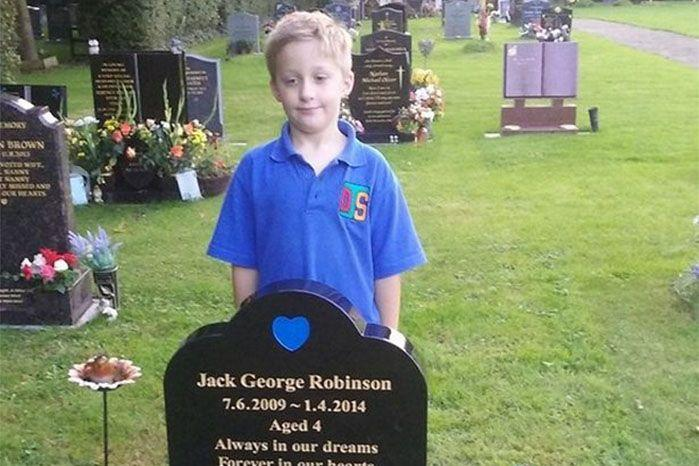 Jack's identical twin brother, Liam, visits his brother's grave. Source: Facebook