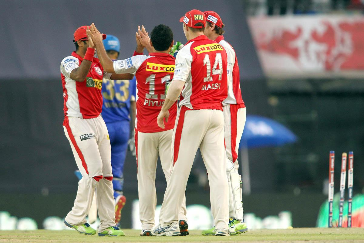 Piyush Chawla of Kings XI Punjab is congratulated for bowling Shane Watson of Rajasthan Royals during match 55 of of the Pepsi Indian Premier League between The Kings XI Punjab and the Rajasthan Royals held at the PCA Stadium, Mohali, India on the 9th May 2013. (BCCI)