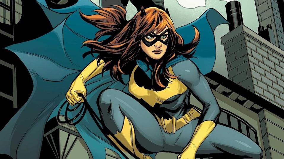 Batgirl crouches on a rooftop in an image from the DC Comics series.