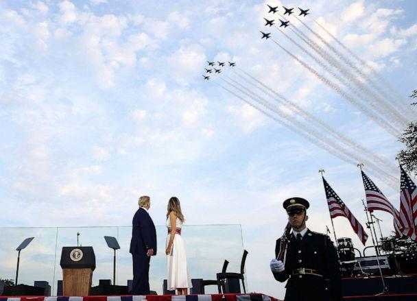 PHOTO: President Donald Trump and first lady Melania Trump watch the U.S. Navy Blue Angels and U.S. Air Force Thunderbirds perform a flyover near the White House on July 4, 2020 in Washington, D.C. (Tasos Katopodis/Getty Images)