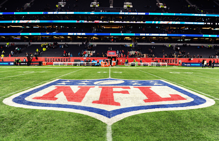 Detailed view of the NFL logo on the field.