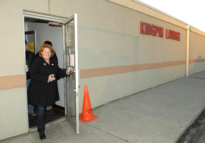 Democratic candidate for the North Dakota's U.S. Senate seat, Heidi Heitkamp, leaves her polling place  in the Kingpin Lounge of a bowling alley after voting, in Mandan, N.D., on Tuesday Nov. 6, 2012. (AP Photo/Will Kincaid)