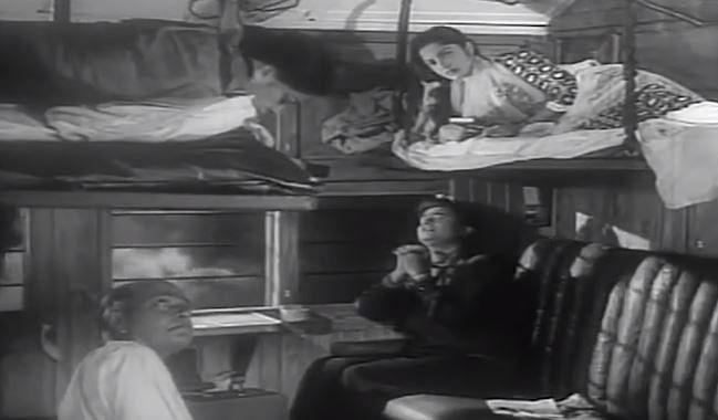 "<div class=""paragraphs""><p>A still from 'Kala Bazar' wherein Waheeda rests on the 'uparwala' seat</p></div>"