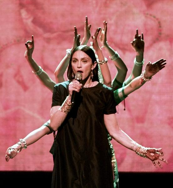 "<div class=""caption-credit""> Photo by: Getty Images</div><div class=""caption-title""></div><b>Performing ""Shanti / Ashtangi"" at the 1998 MTV VMAs</b> <br> To promote her new ""Ray of Light"" album Madonna appeared on stage with many arms to resemble Kali, the Hindu goddess. This look single-handedly started the henna tattoo craze."