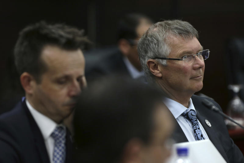 New Zealand Trade and Export Growth Minister David Parker, right, attends a Trans Pacific Partnership (TPP) ministerial meeting on the sidelines of the Asia-Pacific Economic Cooperation (APEC) leaders summit Thursday, Nov. 9, 2017 in Danang, Vietnam. (AP Photo/Na Son Nguyen, Pool)