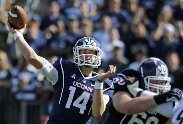 Connecticut quarterback Tim Boyle (14) passes during the first half of an NCAA college football game against South Florida in East Hartford, Conn., on Saturday, Oct. 12, 2013. (AP Photo/Fred Beckham)