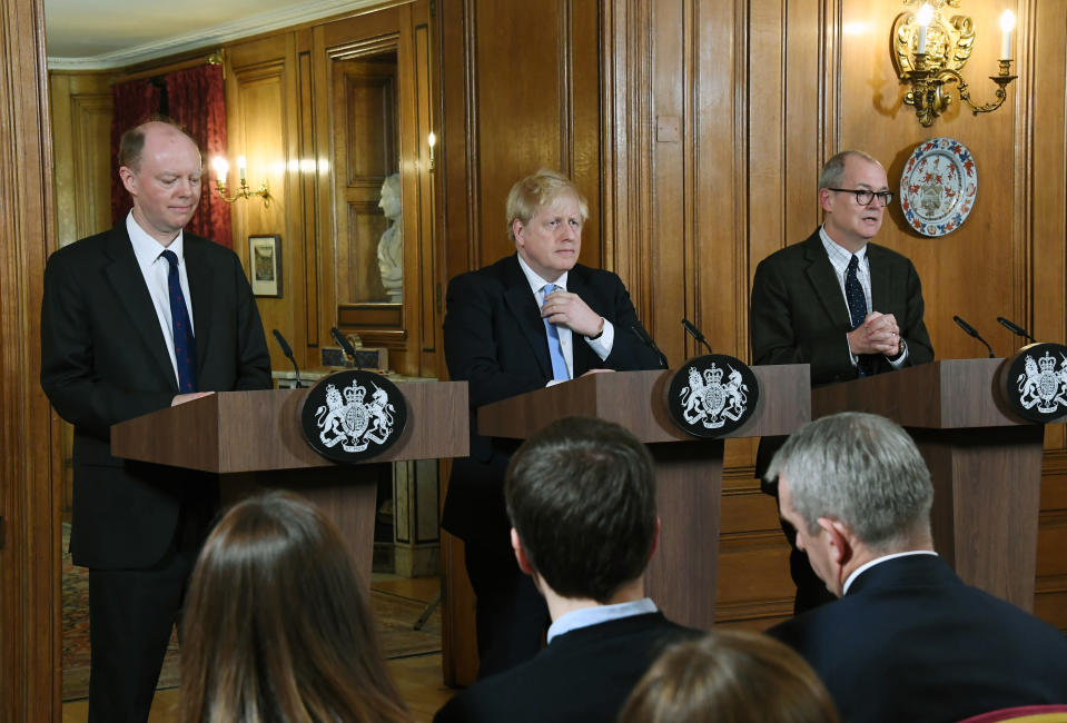 FILE - In this Monday, March 9, 2020 file photo, from left, Chief Medical Officer for England Chris Witty, Britain's Prime Minister Boris Johnson and Chief Scientific Adviser Patrick Vallance speak during a press conference about coronavirus in 10 Downing Street in London. Britain botched its response to the coronavirus the first time around. Now many scientists fear it's about to do it again. The virus is on the rise again in the U.K., which has recorded almost 42,000 COVID-19 deaths, with confirmed infections at their highest level since May. (AP Photo/Alberto Pezzali, File)