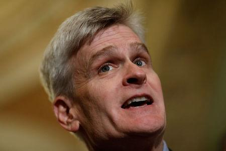 Sen. Bill Cassidy (R-LA) speaks with reporters about the Cassidy-Graham healthcare bill following the party luncheons on Capitol Hill in Washington, U.S., September 19, 2017. REUTERS/Aaron P. Bernstein