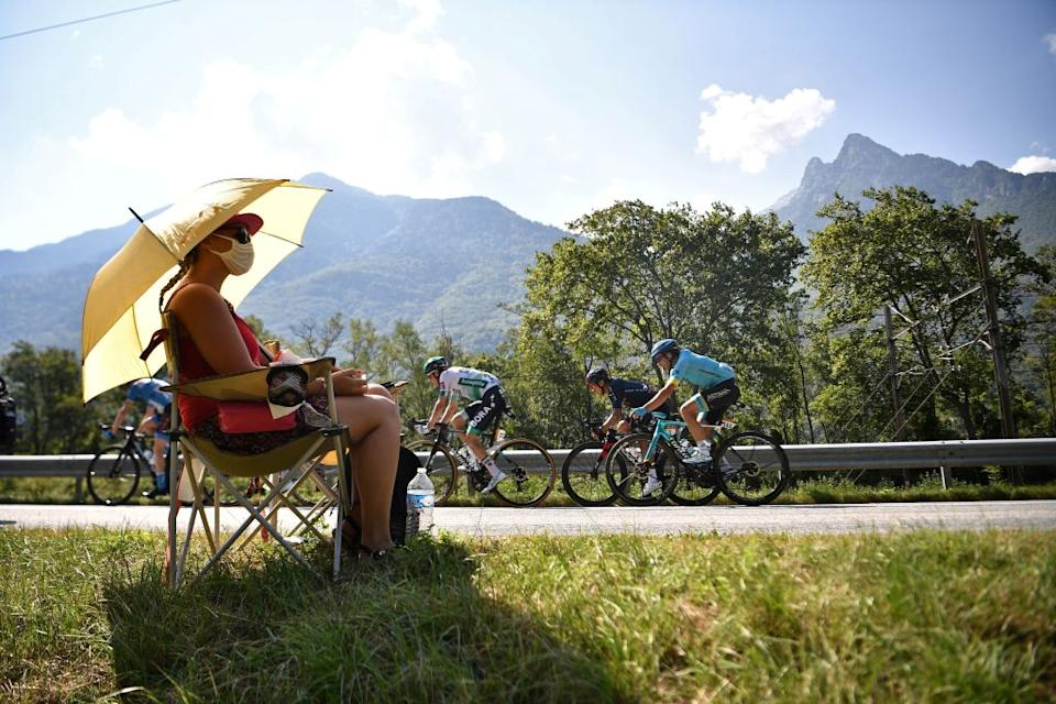 A woman watches the escapees riding during the 17th stage of the 107th edition of the Tour de France cycling race 170 km between Grenoble and Meribel on September 16 2020 Photo by AnneChristine POUJOULAT  AFP Photo by ANNECHRISTINE POUJOULATAFP via Getty Images