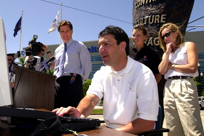 FILE - In this May 31, 2000 file photo, Olympic medalist Andy Gabel demonstrates how to purchase 2002 Winter Game tickets via the Internet during a news conference in Salt Lake City. Looking on is Salt Lake Organizing Committee president Mitt Romney, left,  and Olympic medalists Hilary Lindh and Denise Parker, right.  U.S. Speedskating began an investigation Friday, March 1, 2013, into the report of a female skater accusing former Olympian and organization president Andy Gabel of sexual abuse in the 1990s. (AP Photo/Douglas C. Pizac, File)
