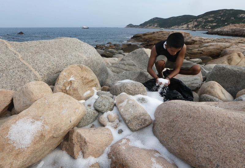 HK struggles to clean plastic pellets from beaches