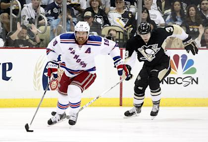 After being bought out by the Rangers, Brad Richards accepted a 1-year, $2 million deal with the Blackhawks. (USA Today)