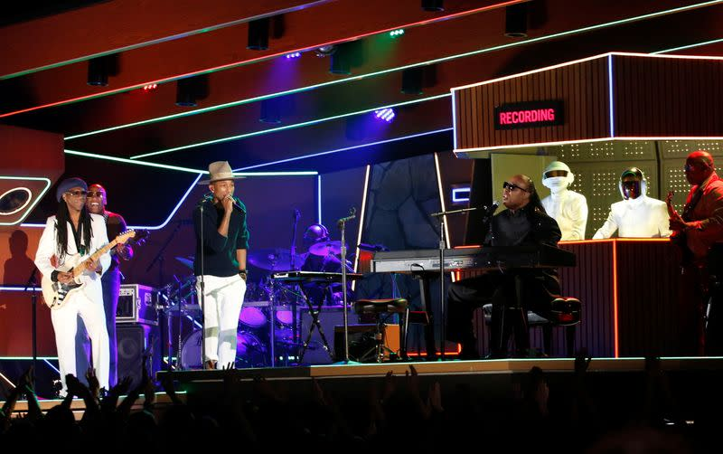 """FILE PHOTO: Wonder performs the Daft Punk's song """"Get Lucky"""" with Williams and Rodgers at the 56th annual Grammy Awards in Los Angeles"""
