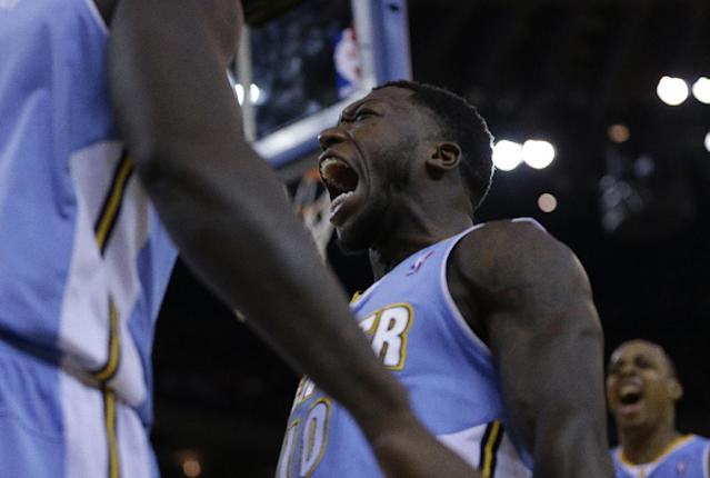 Denver Nuggets' Nate Robinson, center, celebrates a score against the Golden State Warriors during the second half of an NBA basketball game on Wednesday, Jan. 15, 2014, in Oakland, Calif. (AP Photo/Ben Margot)