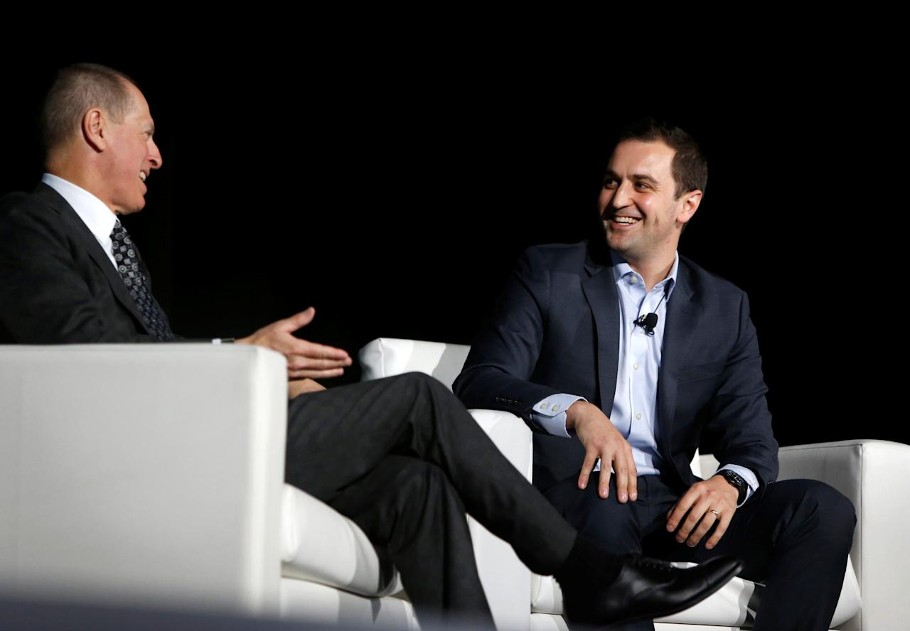 Lyft co-founder and president John Zimmer (R) speaks with Gary Shapiro, president/CEO of the Consumer Technology Association, at a Leaders in Technology dinner during the 2018 CES in Las Vegas, Nevada, U.S. January 10, 2018. REUTERS/Steve Marcus
