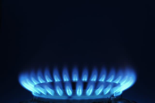 Close-Up Of The Blue Flame Of A Gas Burner