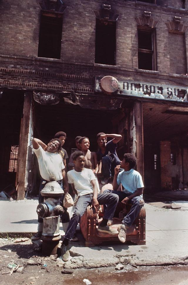 "<p>Bankrupt owners abandon buildings full of furniture, leaving a perfect playground for the city's youth. The long, hot summer of August 1971 exacerbated tensions in the black ghetto. Poor housing, tear down or burned building, poverty, unemployment and crime did not facilitate the poor inhabitants during the heatwave. (Photo: ""New York City Up and Down"" by Jean-Pierre Laffont, copyright © 2017, published by Glitterati Inc. <a href=""https://glitteratiincorporated.com"" rel=""nofollow noopener"" target=""_blank"" data-ylk=""slk:https://glitteratiincorporated.com"" class=""link rapid-noclick-resp"">https://glitteratiincorporated.com</a>) </p>"