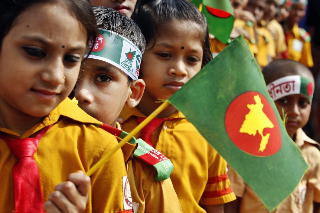 Young Bangladeshi children hold the national flags as they pay tribute to martyrs of the liberation war at the National Memorial during the Independence Day celebrations at Saver on the outskirts of Dhaka, Bangladesh, Monday, March 26, 2012. Bangladesh celebrates its 41st independence day Monday. (AP Photo/Pavel Rahman)
