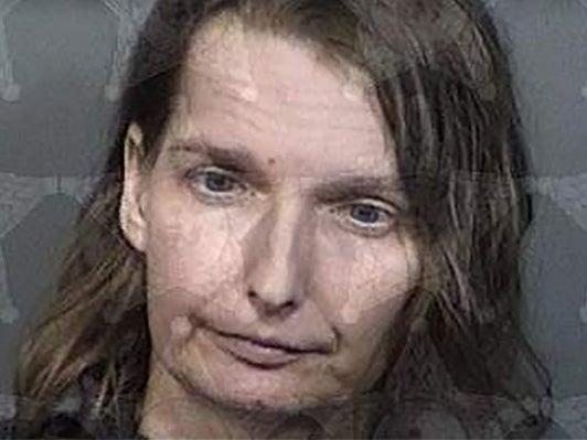 Melissa Doss, 43, was arrested after police found her autistic daughter had been kept in a wood and metal cage in her Florida home.  (Brevard County Sheriff's Office)