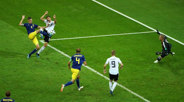 Soccer Football - World Cup - Group F - Germany vs Sweden - Fisht Stadium, Sochi, Russia - June 23, 2018 Germany's Thomas Muller shoots at goal as Sweden's Mikael Lustig pressures REUTERS/Hannah McKay