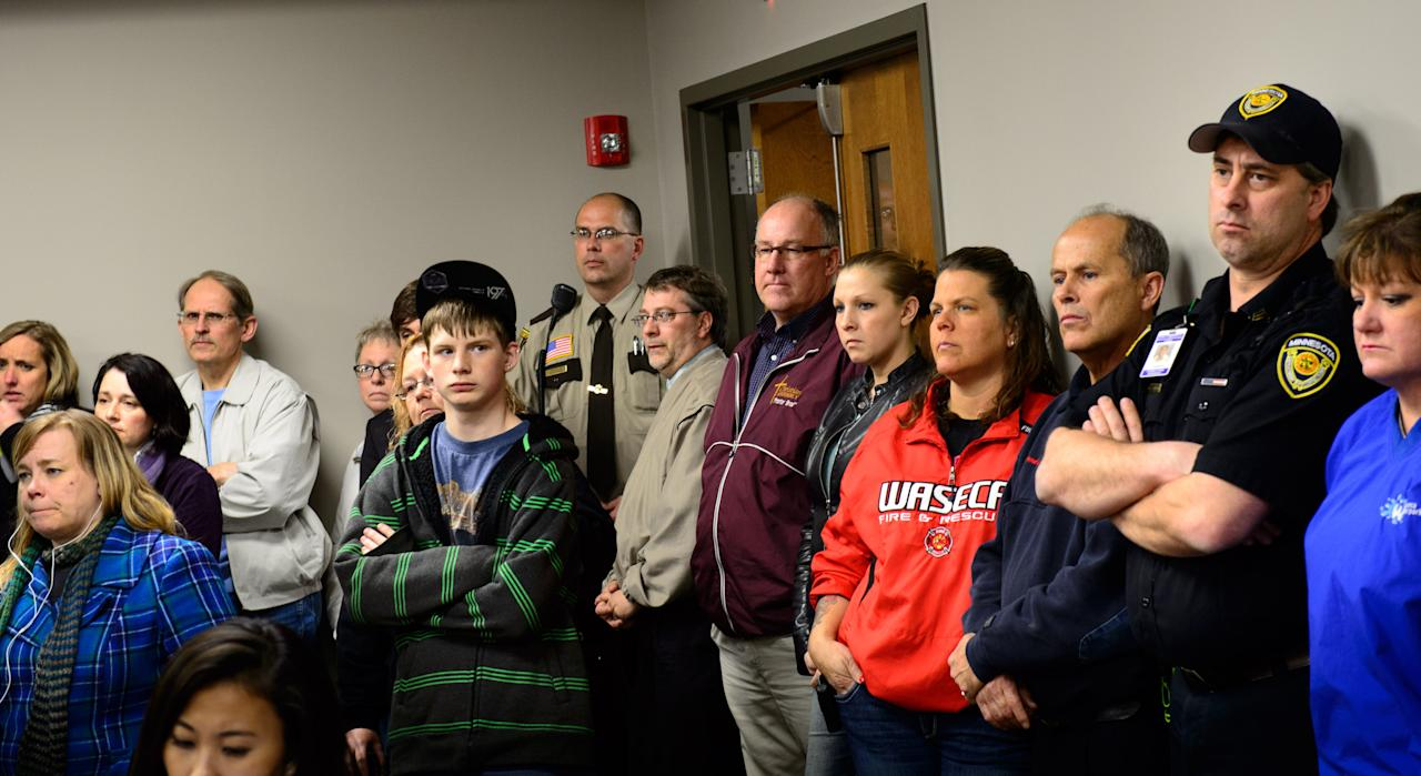 "Students, parents and community members stand in the back of the room to listen as Waseca Police Captain Kris Markeson and Waseca school Superintendent Tom Lee speak at a news conference about the 17-year-old arrested in a plot to kill his family and massacre students. Authorities said Thursday, May 1, 2014, that they prevented an ""unimaginable tragedy"" by foiling the teenager's elaborate plot to kill his family and bomb the junior and senior high school in the southern Minnesota city of Waseca. (AP Photo/The Star Tribune,Glen Stubbe)"