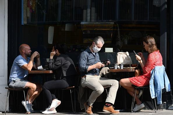 Members of the public sit outside as they enjoy the weather in southwest London.
