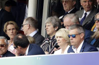 Prime Minister Theresa May sits flanked by her husband Philip during the Cricket World Cup final (AP Photo/Matt Dunham)