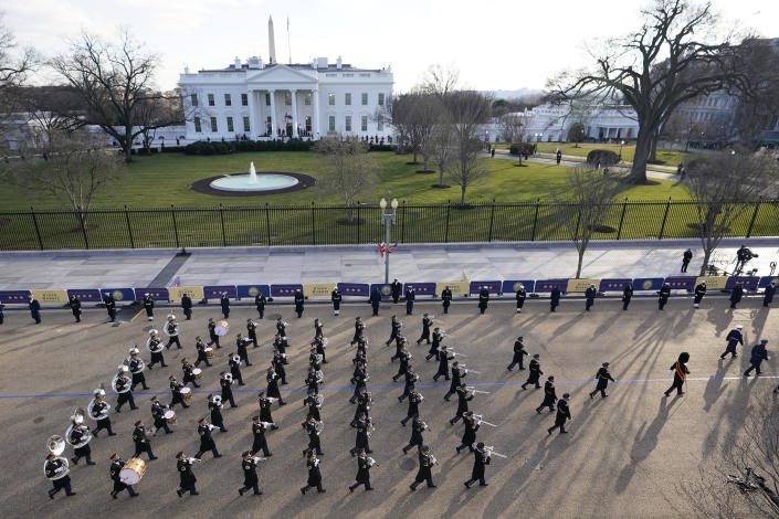 A U.S. Army band marches near the White House during the Presidential Escort, part of Inauguration Day ceremonies, Wednesday, Jan. 20, 2021, in Washington. (AP Photo/David J. Phillip)